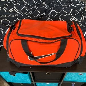 Orange Nike duffel bag